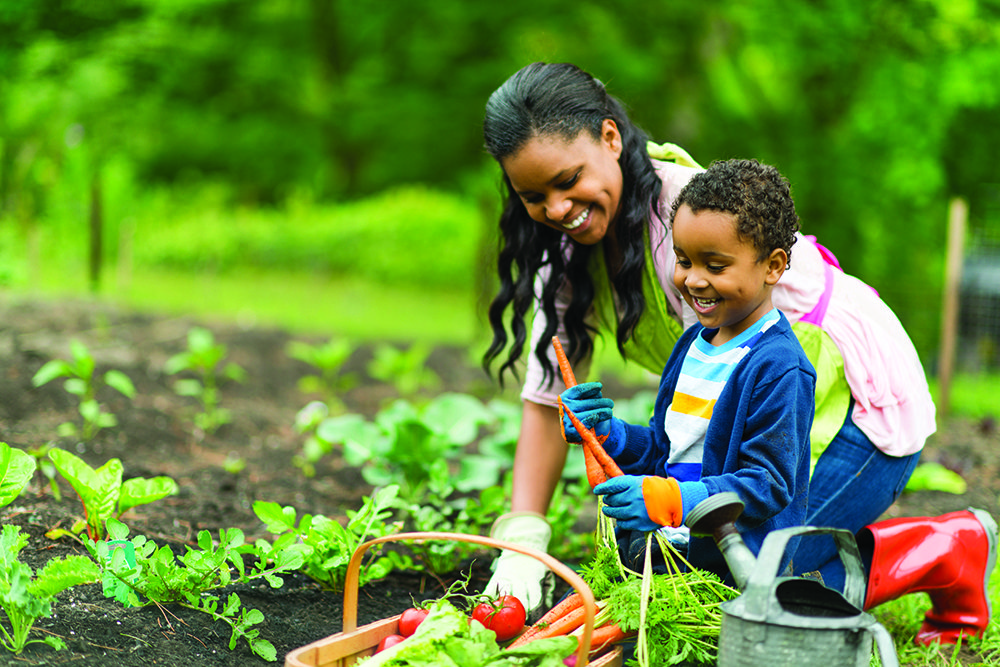 Mom and son living the better life through gardening.