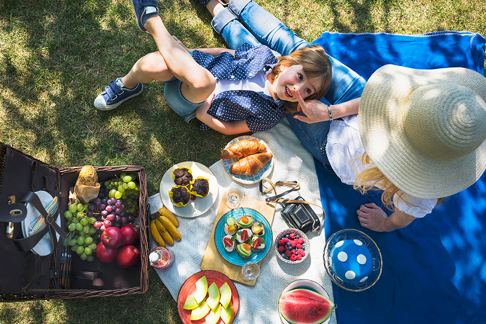 Mother and son enjoying a picnic together
